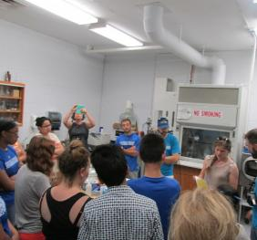 A group of people standing in a science lab